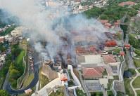 Smoke rises from Shuri Castle in the Okinawa Prefecture capital of Naha on Oct. 31, 2019. (Photo courtesy of the Ryukyu Shimpo)