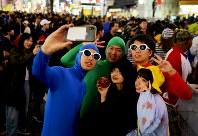 People dressed in Halloween costumes take a selfie near Shibuya Station in Tokyo's Shibuya Ward on Oct. 31, 2019. (Mainichi/Daiki Takikawa)