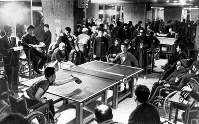1964 Tokyo Paralympics -- Athletes compete in table tennis. The Japanese pair of Yasunori Igari and Fujio Watanabe won the gold medal in the men's doubles.