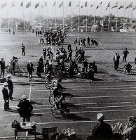 1964 Tokyo Paralympics -- Athletes using wheelchairs compete in a race.