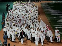 2004 Athens Paralympics -- The Japanese delegation parades during the opening ceremony. About 3,900 athletes from 136 nations and regions competed in 162 events in 19 sports. Japan won 17 gold, 15 silver and 20 bronze medals. (Mainichi/Kimitaka Takeichi)