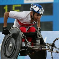 2004 Athens Paralympics -- Japan's Toshihiro Takada competes in men's wheelchair athletics. Takada won the gold medal in the wheelchair 400 meters, 5,000 meters and marathon.