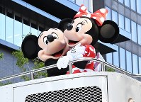 Mickey Mouse and Minnie Mouse share a hug during the