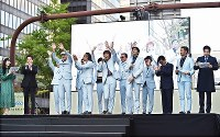 Members of the Tokyo Ska Paradise Orchestra wave at the audience during the