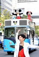 Mickey Mouse and Minnie Mouse wave to the audience during the