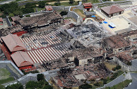 In this photo taken on Nov. 6, 2019, from a Mainichi helicopter, the Shuri Castle complex that was razed by a fire is seen in the Okinawa Prefecture capital of Naha. (Mainichi/Naotsune Umemura)