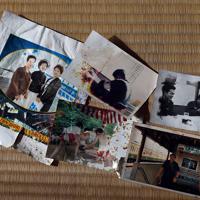 佐々木さん夫婦が行方不明となっている土砂崩れの現場で発見された写真の一部。東京消防庁の職員だった頃の睦さん(上中央、右上)などが写っていた=相模原市緑区牧野で2019年11月3日、北山夏帆撮影