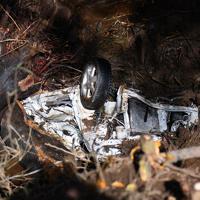 佐々木さん夫婦が行方不明となっている土砂崩れの現場で発見された軽乗用車。夫婦が所有していた車3台のうちの1台で、流木などによって大きくゆがんでいる=相模原市緑区牧野で2019年11月3日、北山夏帆撮影