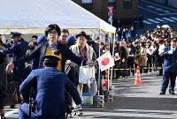 Spectators are seen going through security checks ahead of the parade to celebrate Emperor Naruhito's enthronement, in front of the Imperial Palace in Tokyo, on Nov. 10, 2019. (Mainichi/Takehiko Onishi)