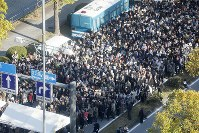 Spectators line up to go through security checks in Tokyo's Chiyoda Ward ahead of the parade to celebrate Emperor Naruhito's enthronement, on Nov. 10, 2019. (Mainichi/Akihiro Ogomori)