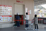 The entrance to a Costco outlet, which a car rammed into during a robbery, is seen in Kitakyushu, Fukuoka Prefecture, on Nov. 12, 2019. (Mainichi/Fumito Tsushima)
