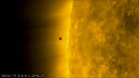This still image from video issued by NASA's Solar Dynamics Observatory shows Mercury as it passes between Earth and the sun on Nov. 11, 2019. (NASA Solar Dynamics Observatory via AP)