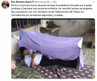 This screen grab of a tweet posted on the account of Bolivia's former President Evo Morales on Nov. 11, 2019, shows him lying on the floor at an undisclosed location and a text that reads in Spanish