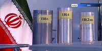 In this June 6, 2018 frame grab from the Islamic Republic Iran Broadcasting, state-run TV, three versions of domestically-built centrifuges are shown in a live TV program from Natanz, an Iranian uranium enrichment plant, in Iran. (IRIB via AP)