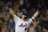 In this Sept. 28, 2019, file photo, New York Mets' Pete Alonso reacts after hitting a home run during the third inning of a baseball game against the Atlanta Braves, in New York. (AP Photo/Adam Hunger)
