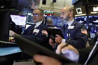 Specialist Anthony Rinaldi, left, and trader Fred DeMarco work on the floor of the New York Stock Exchange, on Nov. 12, 2019. (AP Photo/Richard Drew)
