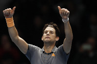 Austria's Dominic Thiem celebrates after defeating Serbia's Novak Djokovic in their ATP World Tour Finals singles tennis match at the O2 Arena in London, on Nov. 12, 2019. (AP Photo/Alastair Grant)
