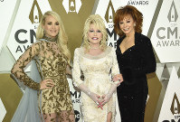 Carrie Underwood, from left, Dolly Parton, and Reba McEntire arrive at the 53rd annual CMA Awards at Bridgestone Arena on Nov. 13, 2019, in Nashville, Tenn. (Photo by Evan Agostini/Invision/AP)