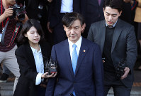 In this Oct. 14, 2019 file photo, South Korean Justice Minister Cho Kuk, center, leaves the Gwacheon Government Complex in Gwacheon, South Korea. (Ryu Hyung-suck/Yonhap via AP)