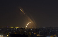 Rockets are launched from the Gaza Strip towards Israel, on Nov. 13, 2019. (AP Photo/Khalil Hamra)