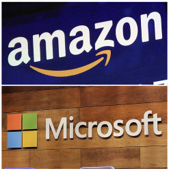 This combination of file photos shows the logos for Amazon, top, and Microsoft. (AP Photo/Richard Drew and Ted S. Warren)