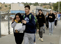 Students are escorted out of Saugus High School after reports of a shooting on Nov. 14, 2019, in Santa Clarita, Calif. (AP Photo/Marcio Jose Sanchez)