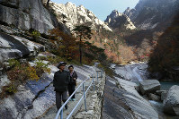 In this Oct. 23, 2018 file photo, local tourists walk on the trail at Mount Kumgang, known as Diamond Mountain, in North Korea. (AP Photo/Dita Alangkara)