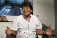 Former Bolivian President Evo Morales speaks during an interview with The Associated Press in Mexico City, on Nov. 14, 2019. (AP Photo/Eduardo Verdugo)