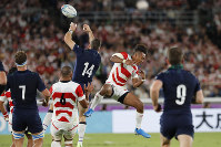 In this  Oct. 13, 2019 file photo, Scotland's Tommy Seymour, top left, and Japan's Kotaro Matsushima vie for the ball during the Rugby World Cup Pool A game at International Stadium between Japan and Scotland in Yokohama, Japan. (AP Photo/Eugene Hoshiko)