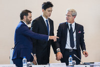 Swimmer Sun Yang, center, from China, arrives for a public hearing at the Court of Arbitration for Sport (CAS) in Montreux, Switzerland, on Nov. 15 2019. (Jean-Christophe Bott/Keystone via AP)