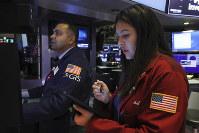 Specialist Dilip Patel, left, and trader Ashley Lara work on the floor of the New York Stock Exchange, on Nov. 15, 2019. (AP Photo/Richard Drew)