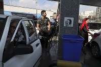 People fill their cars at a gas station in Tehran, Iran, on Nov. 15, 2019. (AP Photo/Vahid Salemi)