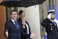 French President Emmanuel Macron gestures as he waits for EU Council President-elect Charles Michel at the Elysee Palace on  Nov. 15, 2019 in Paris. (AP Photo/Michel Euler)
