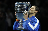 Spain's Rafael Nadal lifts the ATP World Number 1 trophy following the presentation on court after his match against Stefanos Tsitsipas of Greece at the ATP World Tours Finals in the O2 Arena in London, on Nov. 15, 2019. (AP Photo/Alastair Grant)