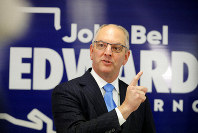 Louisiana Gov. John Bel Edwards talks to media at his campaign office in Shreveport, La., Thursday, Nov. 14, 2019. Edwards, a Democrat, was campaigning in the same metropolitan area his Republican challenger, Eddie Rispone. (AP Photo/Gerald Herbert)