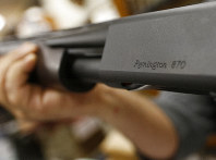 In this March 1, 2018 file photo, the Remington name is seen etched on a model 870 shotgun at Duke's Sport Shop in New Castle, Pa. (AP Photo/Keith Srakocic, File)