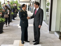 Chinese Defense Minister Wei Fenghe, left, greets U.S. Defense Secretary Mark Esper in Bangkok, Thailand, on Nov. 18, 2019. (AP Photo/Robert Burns)