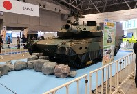 A Ground Self-Defense Force Type 10 tank is seen on display during the