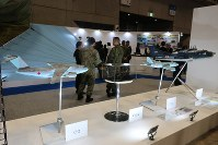 Models of military transport planes and other aircraft are seen on display during the