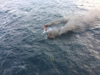 This photo provided by the Korea Jeju Coast Guard shows a fishing boat in a smoke in waters near the southern island of Jeju, in South Korea, on Nov. 19, 2019. (Korea Jeju Coast Guard via AP)