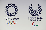 In this April 25, 2016, file photo, official logos of the 2020 Tokyo Olympics, left, and the 2020 Tokyo Paralympic Games are displayed by the Tokyo Organizing Committee, in Tokyo. (AP Photo/Shizuo Kambayashi)