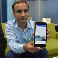 Luitel Mahesh is seen holding up a smartphone with the message he translated and posted to Facebook on it, in Tochigi, Tochigi Prefecture, on Oct. 20, 2019. (Mainichi/Keina Hagihara)