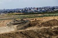 In this Oct. 27, 2018, file photo, Israeli tank takes a position at the Gaza Strip border. (AP Photo/Tsafrir Abayov)