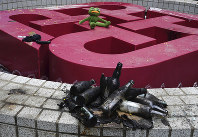 Debris is scattered near the entrance to Hong Kong Polytechnic University in Hong Kong, on Nov. 20, 2019. (AP Photo/Vincent Yu)