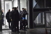In this Nov. 19, 2019 photo a man is arrested by the police at a hospital in Berlin, Germany. (Paul Zinken/dpa via AP)