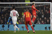 Aaron Ramsey, top right, of Wales scores the opening goal against Hungary, during the Euro 2020 group E qualifying soccer match between Wales and Hungary at Cardiff City Stadium in Cardiff, Wales, on Nov. 19, 2019. (Tamas Kovacs/MTI via AP)