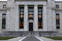 This July 31, 2019 file photo shows the Federal Reserve Building in Washington. (AP Photo/Patrick Semansky)