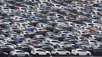 In this July 8, 2019 photo, Subaru cars for export are seen parked at Kawasaki port, near Tokyo. (AP Photo/Koji Sasahara)