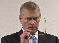 In this file photo dated on Jan. 22, 2015, Britain's Prince Andrew, puts on his glasses prior to his speech to business leaders during a reception at the sideline of the World Economic Forum in Davos. (AP Photo/Michel Euler)