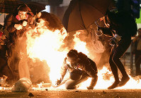 Clashes between protesters and police continue near the Hong Kong Polytechnic University in Kowloon district on Nov. 18, 2019. (Kyodo)